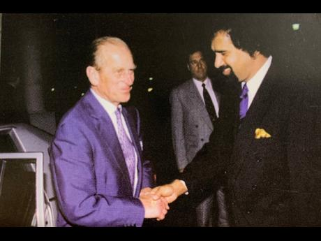 Prince Philip is welcomed by Chandi Jayawardena, general manager at the Le Meridien Jamaica Pegasus Hotel. Prince Philip visited Jamaica in 1998.