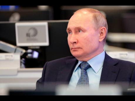 Russian President Vladimir Putin visits the Coordination Center of the Russian Government in Moscow, Russia, on Tuesday.