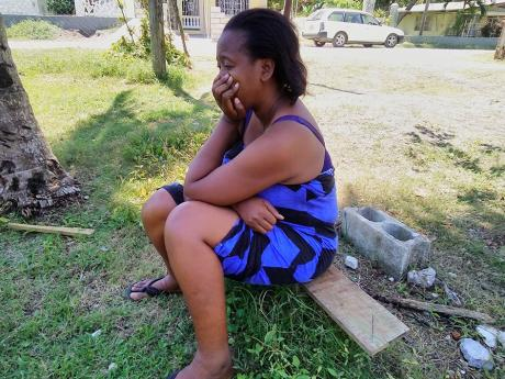 Kadian Hudson is a picture of grief as she mourns the killing of her brother, Chrissel Hudson.