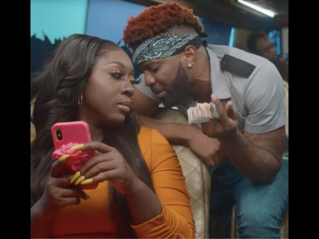 Konshens and Spice in a scene from their new music video, 'Pay For It'.