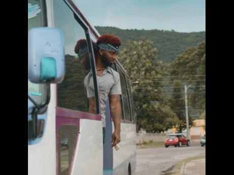 Konshens plays the quintessential 'ducta – in uniform with a kerchief tied around his head.