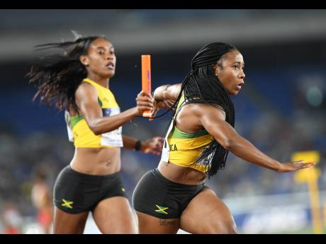 Jamaica's Stephenie Ann McPherson (left) hands off the baton to Shelly-Ann Fraser-Pryce in the women's 4x200m relay at the World Athletics Relay Championships in Yokohama, Japan on Sunday, May 5, 2019.