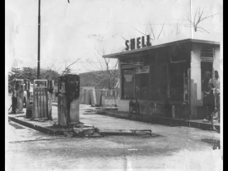 The gas station at Coral Gardens which the gang of Rastafarians attacked, sprayed with gasoline, and set ablaze before dawn on Thursday. Some 6,700 gallons of gas were in the four tanks at the station but did not explode.