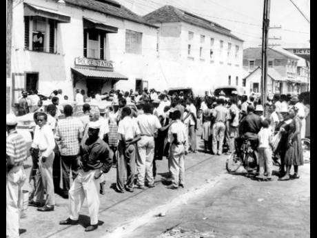 A section of the huge crowd which gathered outside the Montego Bay Police Station after the rounding up of Rastafarians from hilly districts near the town in 1963.
