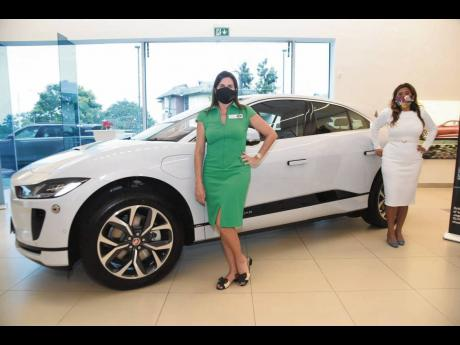 Stewart's Automotive Group Director Jacqueline Stewart-Lechler and Kim del Mondo strike up a pose beside the all-electric 2021 Jaguar I-Pace.