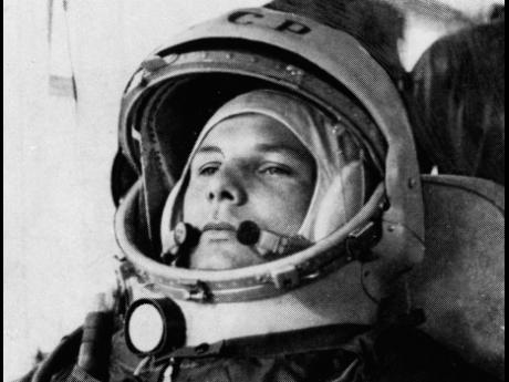 In this undated file photo, Soviet cosmonaut Major Yuri Gagarin, first man to orbit the earth, is shown in his space suit.