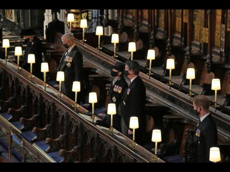 From left: Queen Elizabeth II, Prince Andrew, Princess Anne, Vice Admiral Timothy Laurence and Prince Harry inside St George's Chapel during the funeral of Prince Philip on Saturday.