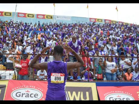 Akeem Weir of Kingston College celebrates in front of his school's supporters after winning the Class Three boys' 400 metres final on the last day of the ISSA/GraceKennedy Boys and Girls' Athletics Championships at the National Stadium on Saturday,