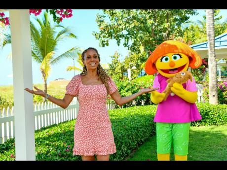 Actress and autism activist, Holly Robinson Peete enjoys a stay at Beaches Resorts alongside Julia, a muppet with autism that provides on-resort activities for those with sensory disorders.