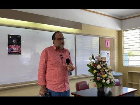 Opposition Leader Mark Golding addresses teachers at the Four Path Primary and Junior High School when he visited last Thursday to express his condolence at the death of grade-three teacher, Nattalie Dawkins.