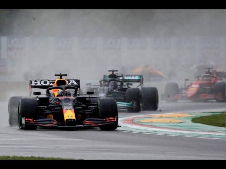 Red Bull driver Max Verstappen of the Netherlands leads Mercedes driver Lewis Hamilton of Britain and Ferrari driver Charles Leclerc of Monaco during the Emilia-Romagna Formula One Grand Prix, at the Imola racetrack in Italy yesterday.