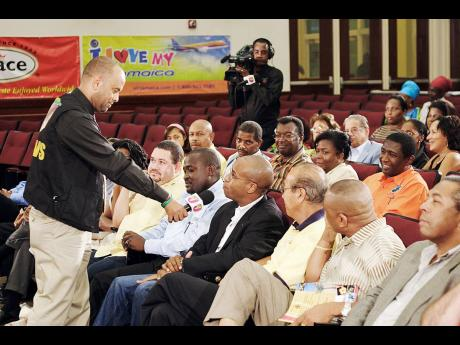 Michael Sharpe (left), the host of Television Jamaica's current affairs programme, 'Your Issues Live',  speaks with Marlon Hill, a member of the Jamaican Diaspora in the United States, during a taping of the programme.