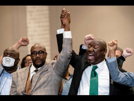 Philonise Floyd (left), brother of the late George Floyd, and attorney Ben Crump celebrate in triumph during a news conference after the murder conviction against former Minneapolis police officer Derek Chauvin on Tuesday.