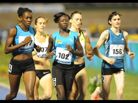 Athletes compete at the Jamaica International Invitational Meet at the National Stadium in 2014.