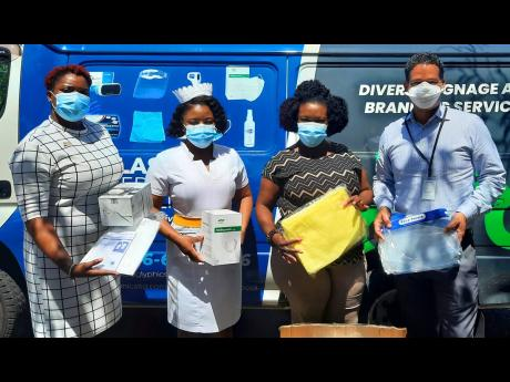 From left: Andrene Anderson-Hutchinson; accountant manager, Hieroglyphics Limited, shares a moment with Cornwall Regional staff members Sheena-Lindo-Kerr; department manager, Accident Emergency and Isolation Unit; Cassandra Lawson-Laing, hospital administr