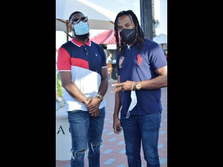Brisco Bal (left) and Ricardo 'Bibi' Gardner were out and about in Portmore, representing the 'high life' for A-Team lifestyle, and one of their stops had to be at JACANA.