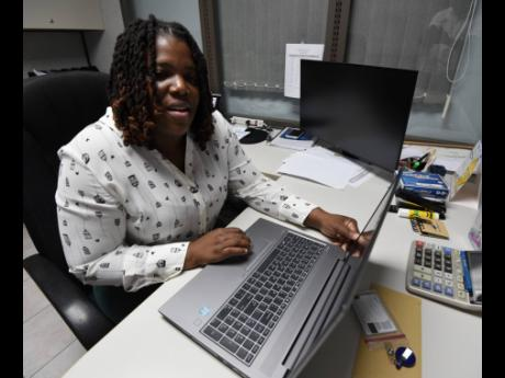 National Works Agency data specialist Shavonne Jennings says she had always been interested in science.