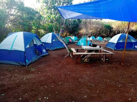 An Outdoors Vybz Survival Adventures campsite on Old Pera – site of an explosive dispute between residents and retired parliamentarian Pearnel Charles Sr.