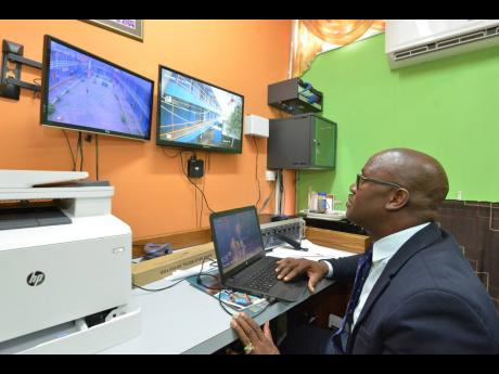 Marvin Johnson, then acting principal of Tivoli Gardens High School in Kingston, monitors the compound via CCTV cameras to ensure safety and security. Noting the benefits of such a system, attorney-at-law Peter Champagnie believes all businesses should be