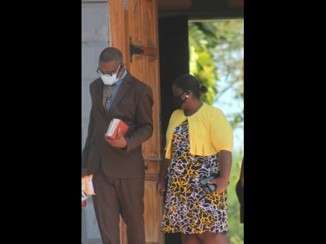 George Wright is seen leaving St Peter's Anglican Church in Petersfield, Westmoreland, on Sunday