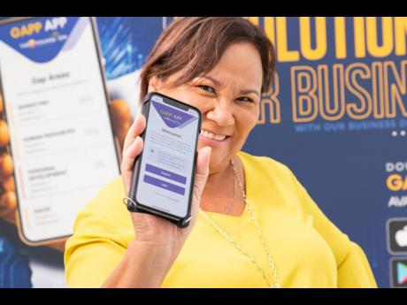 Founder of The Honey Bun Foundation Michelle Chong shows off their business diagnostic app. The app will help micro, small and medium-sized enterprises and those in the creative industry identify the gaps in their businesses and where and how to fill them.