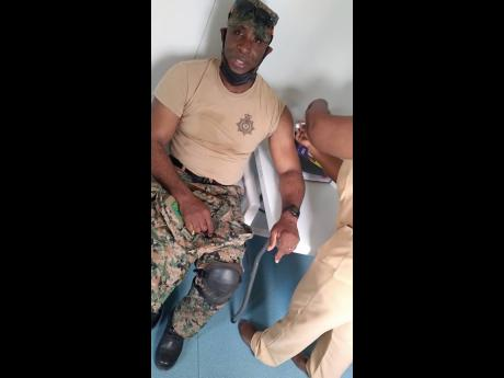 Captain Kerron Speid receives his first dose of the Oxford-AstraZeneca COVID-19 vaccine at the May Pen Hospital in Clarendon on Monday. Jamaica resumed its vaccination drive on Monday a week after a whirlwind blitz that inoculated more than 87,000 people i