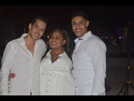 From left: Martin Gallegos, Vladimir Reyes and Nicola Francis are the picture of happiness at the birthday celebration of Dominic Shaw.