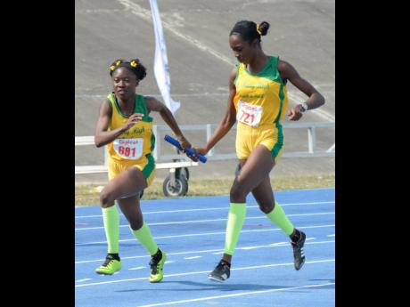 St Mary High school's Keresa Richardson (right) passes the baton to teammate Janelia Campbell during the Class One girls 4x100m final at the Eastern Athletics Championships at the National Stadium in 2019.