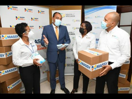 Dr Christopher Tufton, minister of health and wellness (second left) in discussion with Janine Chen (left), chief executive officer, Massy Distribution; Rohan Ambersley, chief executive officer, Massy Gas Products; and  Winsome Gibbs, Massy United Insuranc
