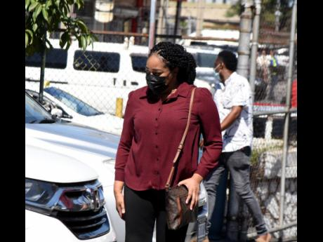 Former manager of NCB, Andrea Gordon, arriving at the Kingston and St Andrew Parish Court to answer to charges of larceny on Thursday. She pleaded guilty to embezzling tens of millions of dollars.