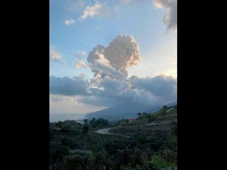 Plumes of ash rise from the Soufrière volcano on the eastern Caribbean island of St Vincent, Friday, April 16.