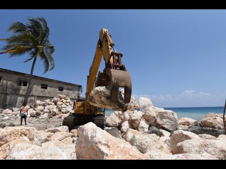 A seawall under construction in Buff Bay.
