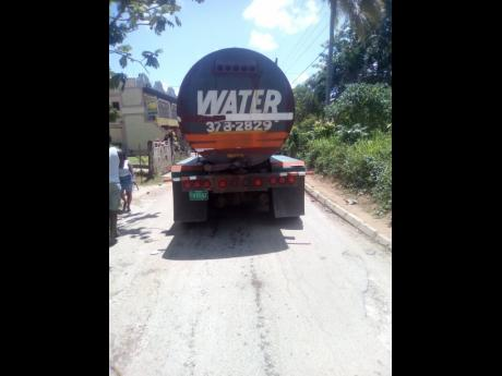 One of the trucks that carries water to residents in the Jericho community.