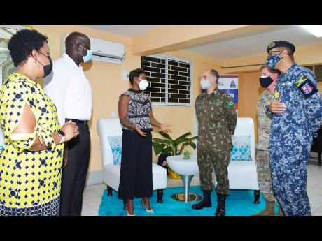 US Army South Deputy Commanding General for Interoperability, Brigadier General Alcides V. Faria (third from right), listens keenly to Minister of State in the Ministry of Health & Wellness, Juliet Cuthbert Flyn, during a recent tour of the US-funded mobil