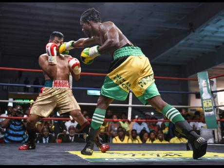 The Wray and Nephew Contender final between Jamaica's Richard 'Frog' Holmes and Canada's Ricardo 'Magic Man' Salas at the National Arena in Kingston on Wednesday, July 25, 2018.