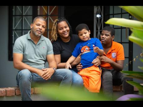 Veronique Pitter is seen with her five-year-old autistic son, Aiden, husband Andrew Watt Sr, and son Andrew Watt Jr.