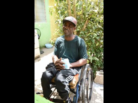 Kenneth Dennis was shot by gunmen while waiting to play a game of dominoes in August Town. He is crippled from the waist down.
