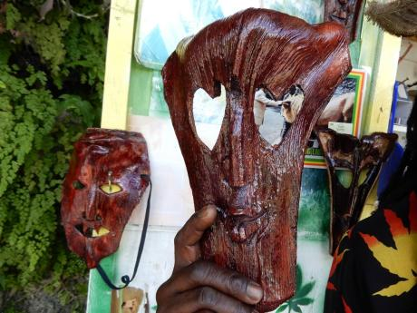 Two of the masks which are made out of coconut bough.