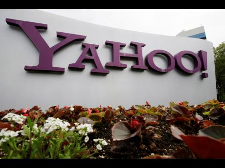 The Yahoo logo is displayed outside of offices in Santa Clara, California, in this April 18, 2011, file photo.