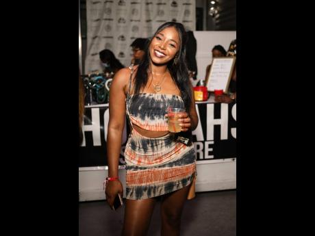 Milinda Smith is all smiles as she enjoys the vibe at Bawd Behaviour for the Xaymaca Weekend in Miami, Florida.