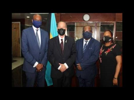 From left: Freedom of Information Commissioner, retired Supreme Court Justice Keith Thompson; Attorney General Carl Bethel; Shane Miller; and Permanent Secretary Cecilia Strachan.