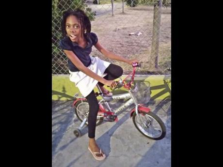 Alannah Morris riding a bicycle.