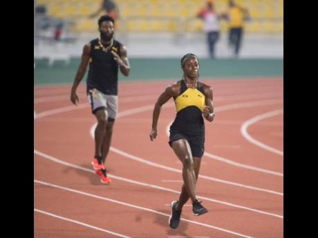 Sprintec Track Club athletes Shashalee Forbes (foreground) and Rasheed Dwyer in a training session at the Qatar Sports Club in Doha, Qatar on Tuesday, September 24, 2019.