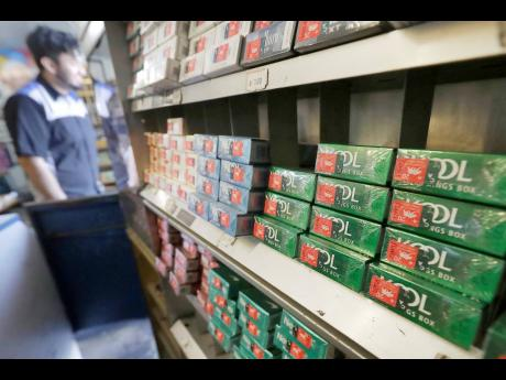 This May 17, 2018 photo shows packs of menthol cigarettes and other tobacco products at a store in San Francisco.