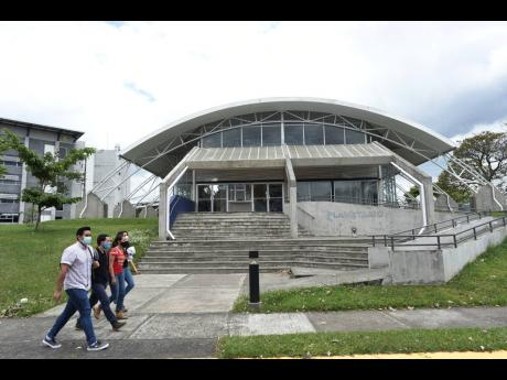 Students walk past the Solar Astronomical Observatory in San Jose, Costa Rica, on Friday, April 30.
