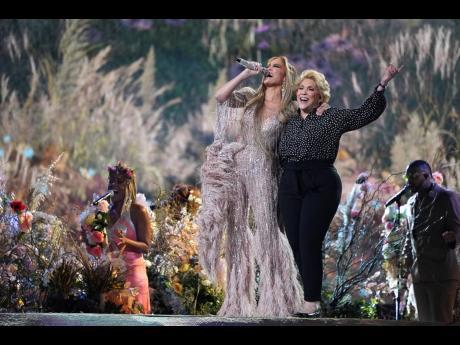 Jennifer Lopez performs Neil Diamond's 'Sweet Caroline' with her mother, Guadalupe Rodríguez.