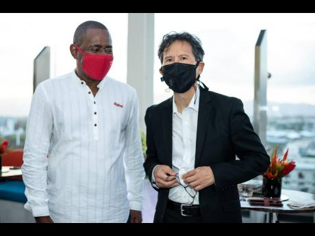Digicel Jamaica Chairman Harry Smith (left) and his fellow board director Anthony Chang at the renaming event.