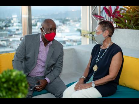 CEO of SportsMax Olly McIntosh in conversation with Citi Country Officer Eva Lewis.