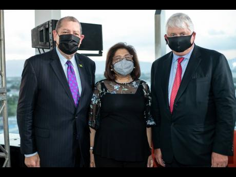 From left: Minister of Industry, Investment and Commerce, Audley Shaw (left), Chairman of the Digicel Foundation, Jean Lowrie-Chin, and founder and Chairman of Digicel Denis O'Brien share lens time.