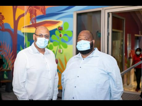 Digicel Group Financial Controller Bejjel Haria (left) and CEO of Main Event Group Solomon Sharpe.